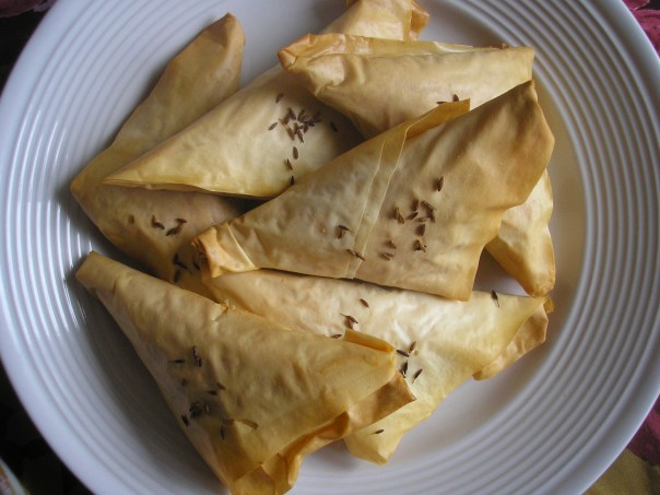 Meat and pine nut pastries